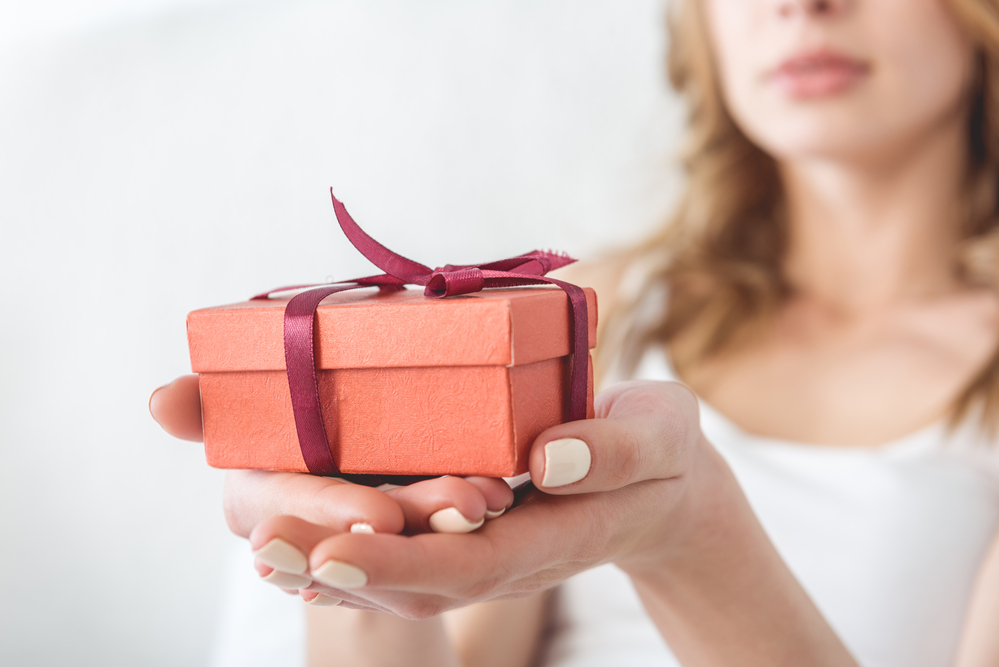 Close up of small gift being held by a woman.