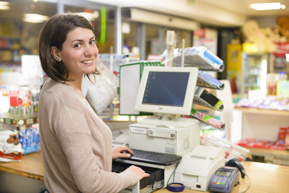 Woman at point of sale terminal.