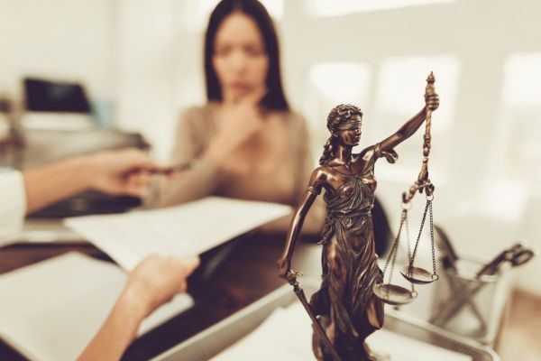 Young Frustrated Woman in Office with Lawyer. Frustrated Woman. Problem in Relationship between People. Modern Law Office. Angry Young Woman. Marriage Problem. Young Advocate.