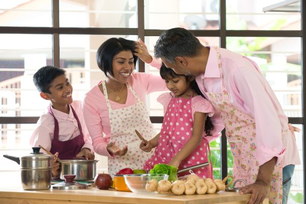 family spending quality time busy cooking at home