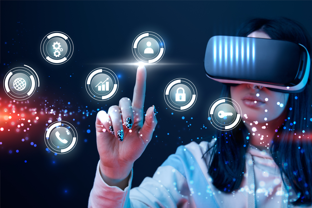 Woman wearing and interacting with virtual reality goggles.